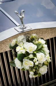 Flowers on Rolls Royce Wedding car